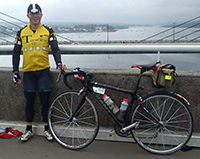Ray Joiner with his bike by a bridge
