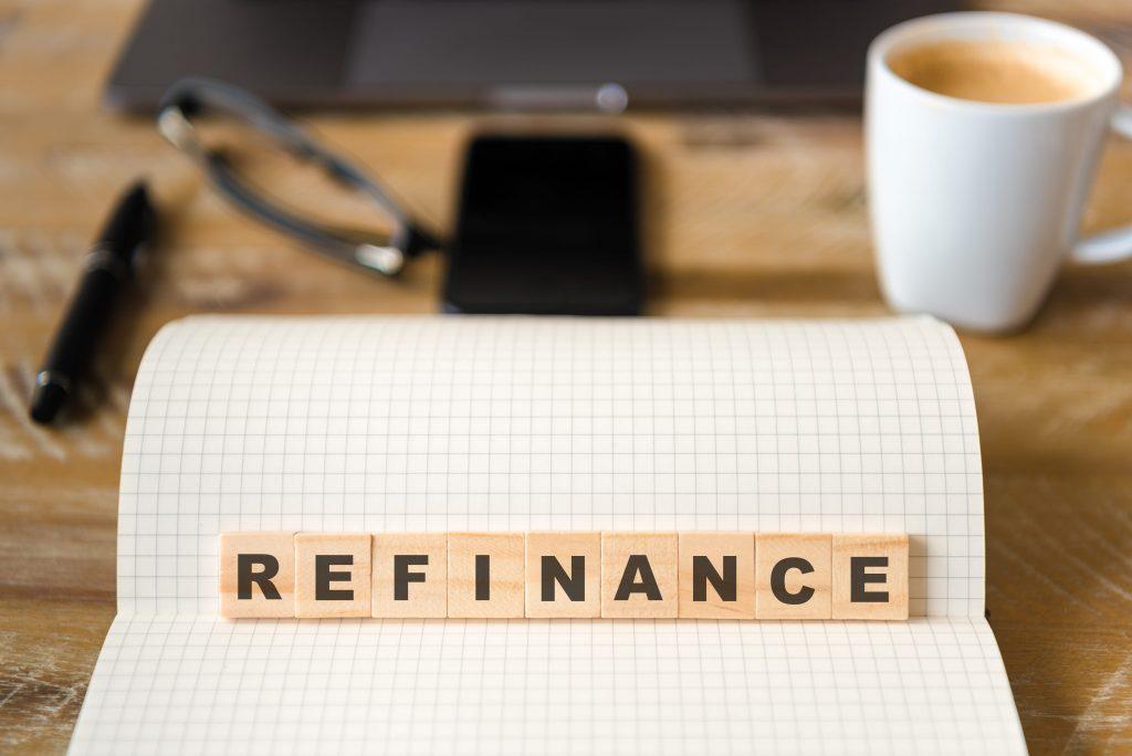 Refinance written in scrabble tiles on a desk