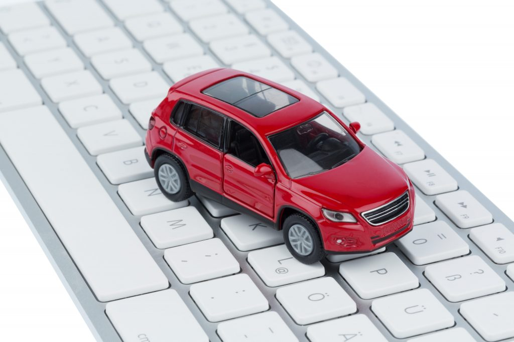 Toy car on a computer keyboard